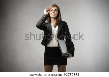 Smiling beautiful businesswoman holding a laptop