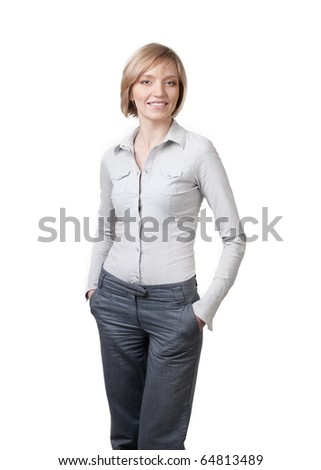 Smiling beautiful businesswoman with hands in pockets standing against isolated white background