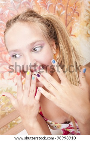 smiling beautiful caucasian girl  with hands which has color nails