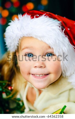 smiling beautiful child in Santa's hat  have a Christmas
