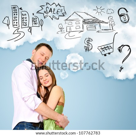 Smiling beautiful couple standing and embracing. Woman dreaming about their future