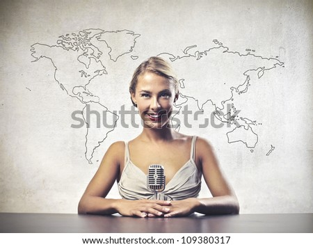 Smiling beautiful female news announcer [Elements of this image furnished by NASA]