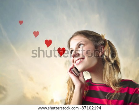 Smiling beautiful woman in love talking on the mobile phone