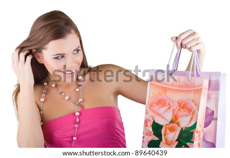 Smiling beautiful woman looking at the shopping bags, isolated on white background