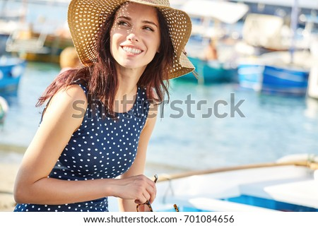 8daaf49d153f2 Smiling beautiful young woman in summer hat