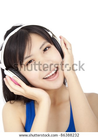 smiling beautiful  young woman  listening to music