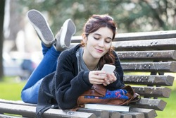 Smiling beautiful young woman looking message on phone, feeling and emotion lifestyle concept.