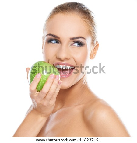Smiling beauty holding green apple while isolated on white