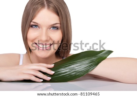 smiling beauty young woman with green leaf, isolated on white background