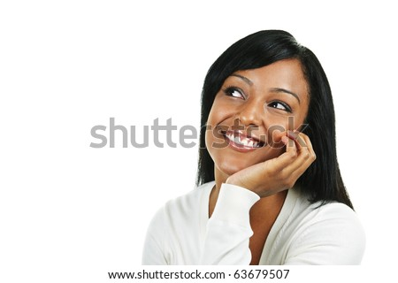 Smiling black woman looking up isolated on white background