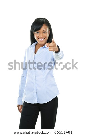 Smiling black woman pointing finger at camera isolated on white background