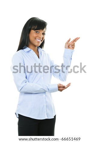 Smiling black woman pointing to the side isolated on white background