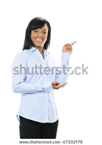Smiling black woman pointing to the side isolated on white background - stock photo