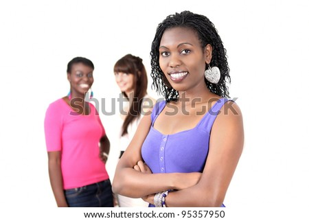 Smiling black woman with colleagues in background