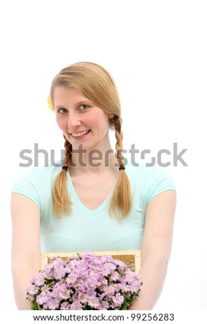 Smiling blond female holding pink flowers on white background