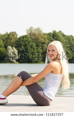 Smiling blond girl in the park