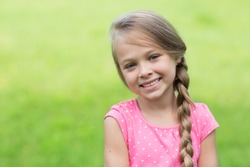Smiling blond girl with braid. Girl seven years.