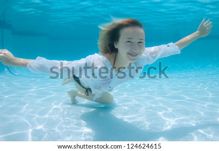 Smiling Blond Haired Model Underwater