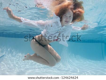 Smiling Blond Haired Model Underwater