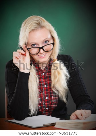 smiling blond student with glasses