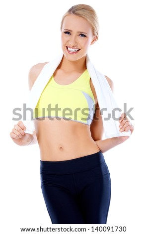 Smiling blond woman standing with towel around her neck  she is isolated on white background