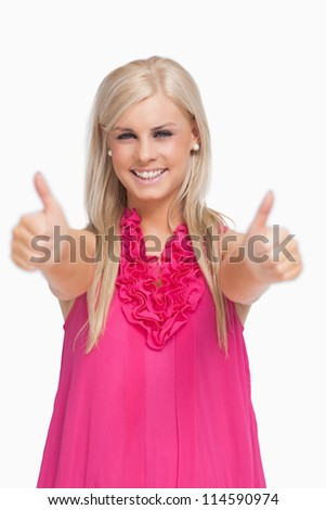 Smiling blonde thumbs-up against white background