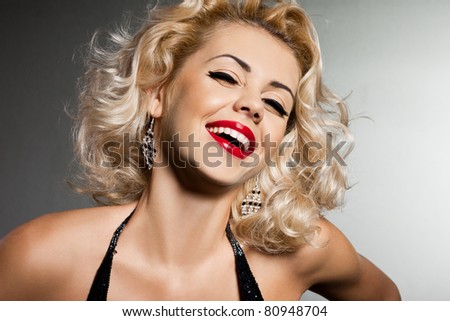smiling blonde woman in black dress