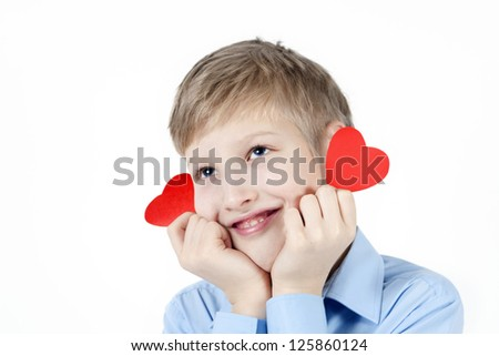 Smiling boy and red hearts.