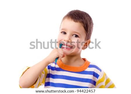 Smiling boy brushing teeth, isolated on white - stock photo