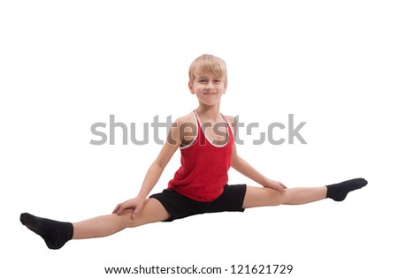 Smiling boy doing horizontal splits, on white background