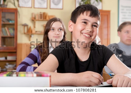 Smiling boy during a lesson at elementary age school