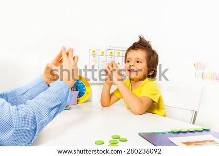 Smiling boy exercises improving motor skills