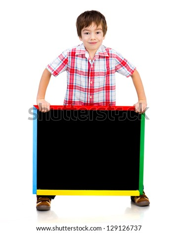 Smiling boy holding a blackboard over white background