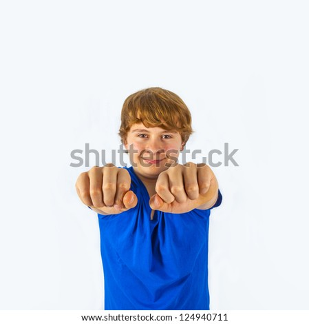 smiling boy is showing his fist  isolated on the white background
