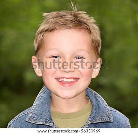 Smiling boy on a green background
