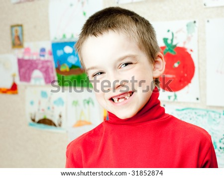 Smiling boy shows lost deciduous teeth