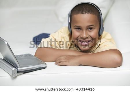 Smiling Boy Watching Portable DVD Player - stock photo