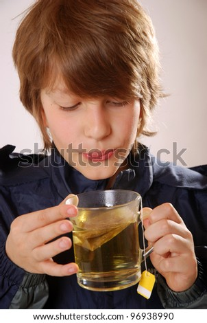 smiling boy with a glass of tea