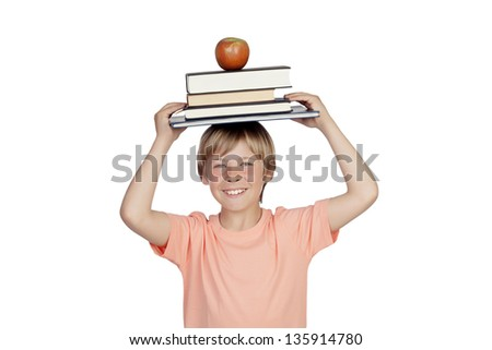 Smiling boy with books and a apple oh his head isolated on white background - stock photo