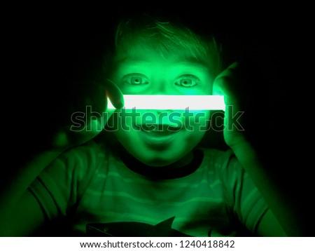 Smiling boy with glow stick