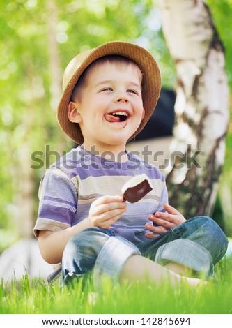 Smiling boy with ice cream