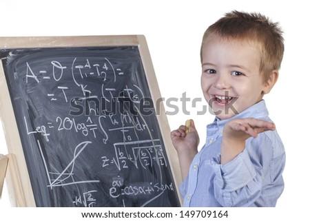 Smiling boy with math's blackboard - stock photo