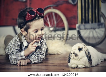 Smiling boy with rabbit