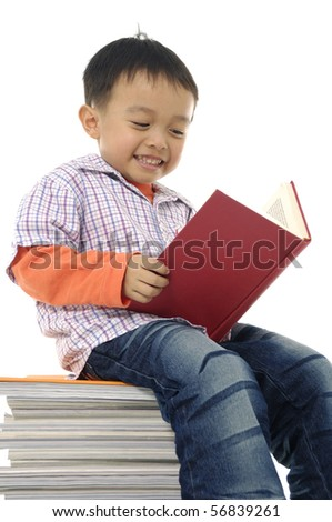 Smiling boy with set of books