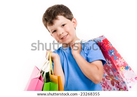 Smiling boy with shopping bags looking at camera wover white background