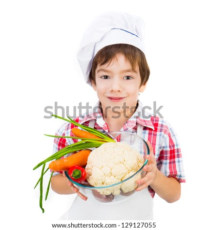 smiling boy with vegetables isolated on a white background