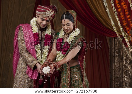 Smiling bride and bridegroom during traditional ceremony