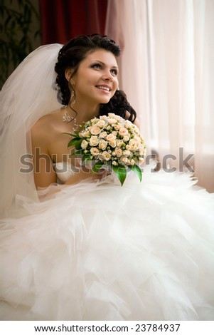 Smiling bride with the bouquet Focus point on the face & bouquet