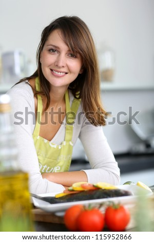 Smiling brunette woman in home kitchen