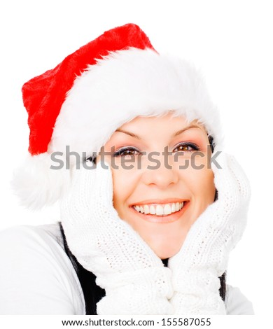 smiling brunette woman in winter christmas clothes over white